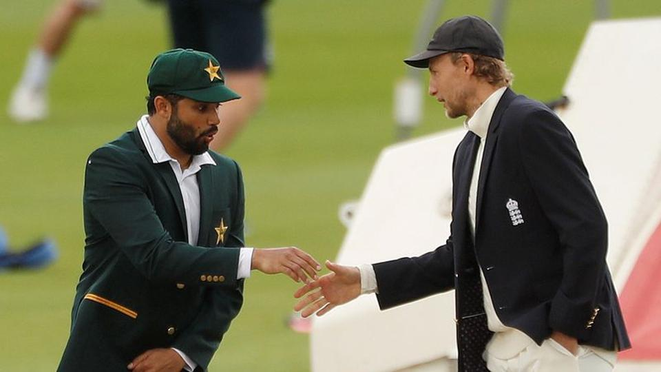 Pakistan's Azhar Ali reacts as he and England's Joe Root shake hands after the coin toss before the start of play.