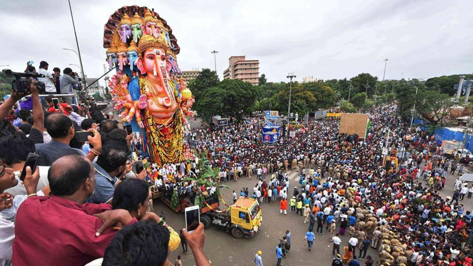 Devotees carry the 61ft tall Lord Ganesh idol for immersion in Hyderabad on September 12, 2019.