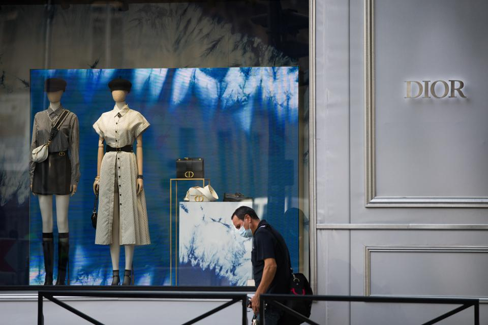 A pedestrian wearing a protective face mask passes the Christian Dior SE flagship luxury goods store, operated by LVMH Moet Hennessy Louis Vuitton SE, on Avenue Montaigne in Paris, France, on Wednesday, Aug. 12, 2020.  (Bloomberg)
