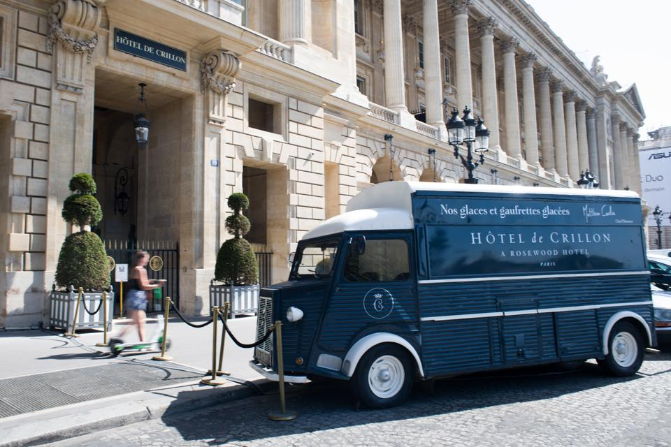 A vintage ice cream truck sits outside the closed Hotel de Crillon, one of the 12 high-end hotels in Paris that are classified as palaces, ahead of reopening, in Paris, France, on Wednesday, Aug. 12, 2020.  (Bloomberg)