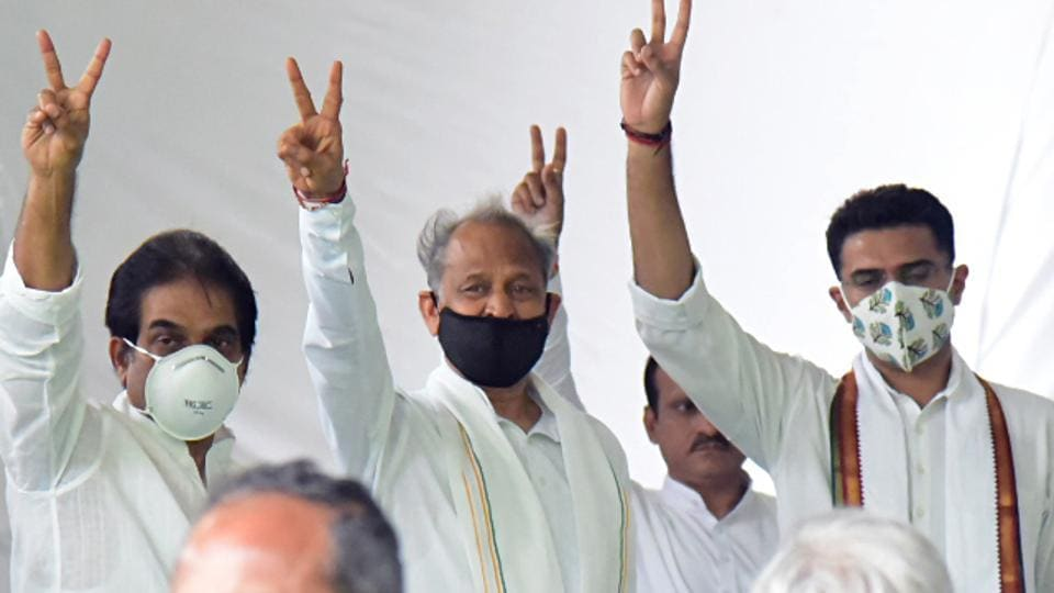 Rajasthan chief minister Ashok Gehlot, Congress leader Sachin Pilot and KC Venugopal show victory sign during a party meeting in Jaipur on Aug 13.