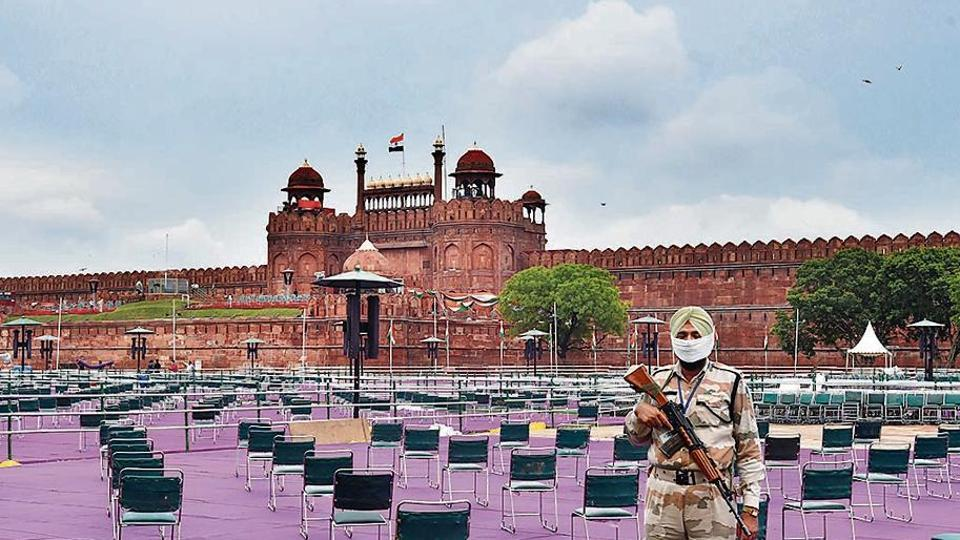 A security person stands guard at Red Fort, ahead of Independence Day.