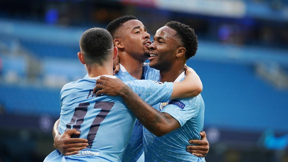 Soccer Football - Champions League - Round of 16 Second Leg - Manchester City v Real Madrid - Etihad Stadium, Manchester, Britain - August 7, 2020 Manchester City's Raheem Sterling celebrates scoring their first goal with teammates, as play resumes behind closed doors following the outbreak of the coronavirus disease (COVID-19) Pool via REUTERS/Dave Thompson