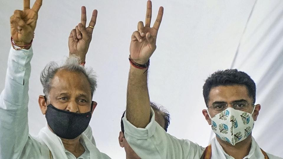 Rajasthan chief minister Ashok Gehlot and Sachin Pilot flash victory signs during the party MLAs meeting, at CM residence in Jaipur on Thursday.