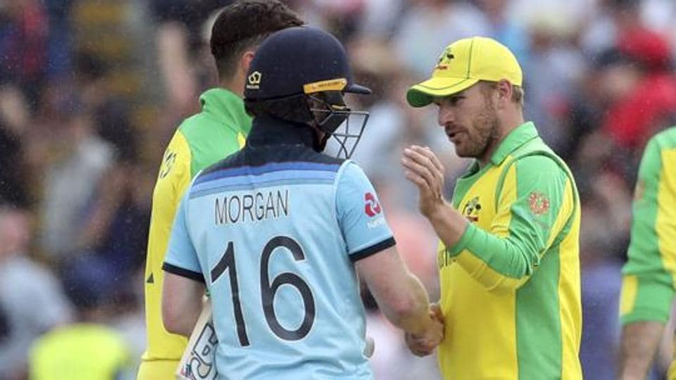 England's captain Eoin Morgan, left, shakes hands with Australia's captain Aaron Finch, right.