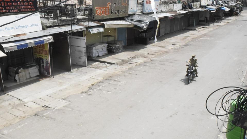 Streets empty and shops closed in Aminabad during a weekend lockdown in Lucknow, Uttar Pradesh.