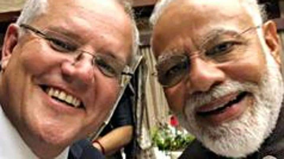 Australian Prime Minister Scott Morrison clicks a selfie with Prime Minister Narendra Modi and during their meeting in Osaka, Japan.