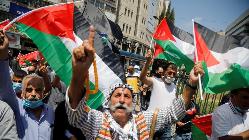Palestinians take part in a protest against the United Arab Emirates' deal with Israel to normalise relations, in Nablus in the Israeli-occupied West Bank.