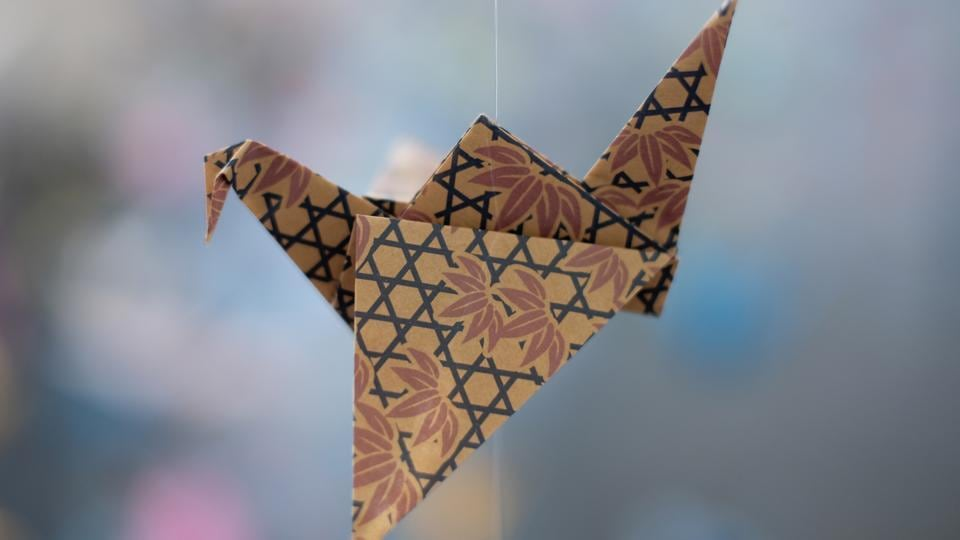 An origami paper crane hangs in the Matter Studio Gallery in Los Angeles, among thousands of others during an exhibit for those who have died in the U.S., of COVID-19, on Tuesday, Aug. 11, 2020.
