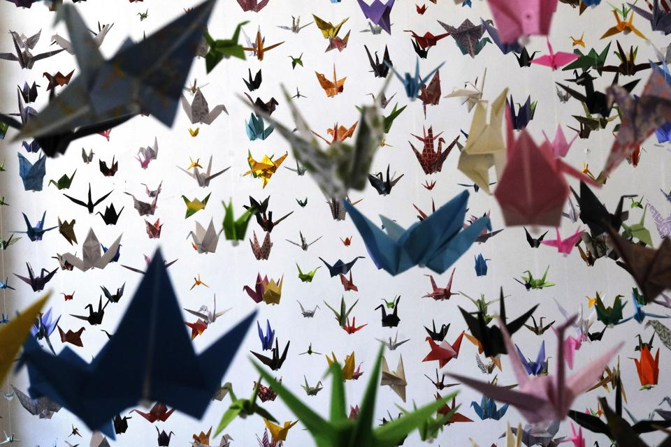 Origami paper cranes hang in the Matter Studio Gallery in Los Angeles during an exhibit for those who have died in the U.S. of COVID-19, on Tuesday, Aug. 11, 2020. Hundreds of origami now hang from the ceiling of Karla Funderburk's Matter Studio with others sitting on tables and stacked in boxes waiting to be added to the sad reminder of the virus' toll. (AP Photo/Richard Vogel) (AP)