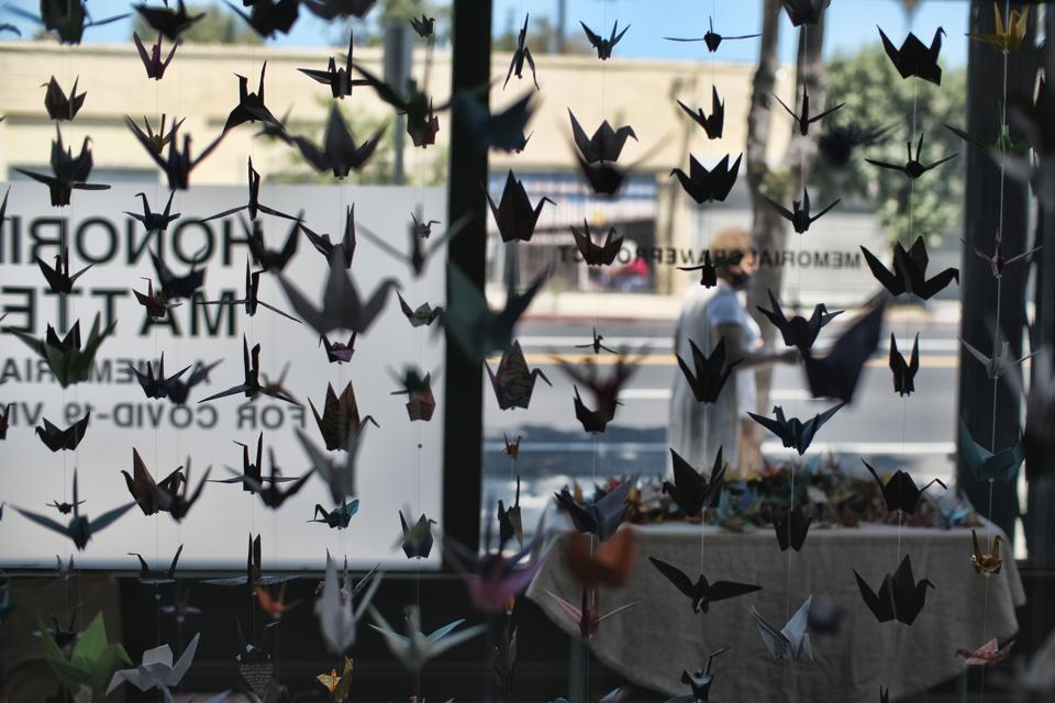Origami cranes hang inside the Matter Studio Gallery during an exhibit honoring those who have died from COVID-19 in the U.S., Tuesday, Aug. 11, 2020, in Los Angeles. Gallery owner Karla Funderburk started the effort. (AP Photo/Richard Vogel) (AP)