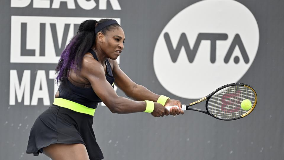 Serena Williams returns a shot to her sister Venus Williams during the WTA tennis tournament in Nicholasville.