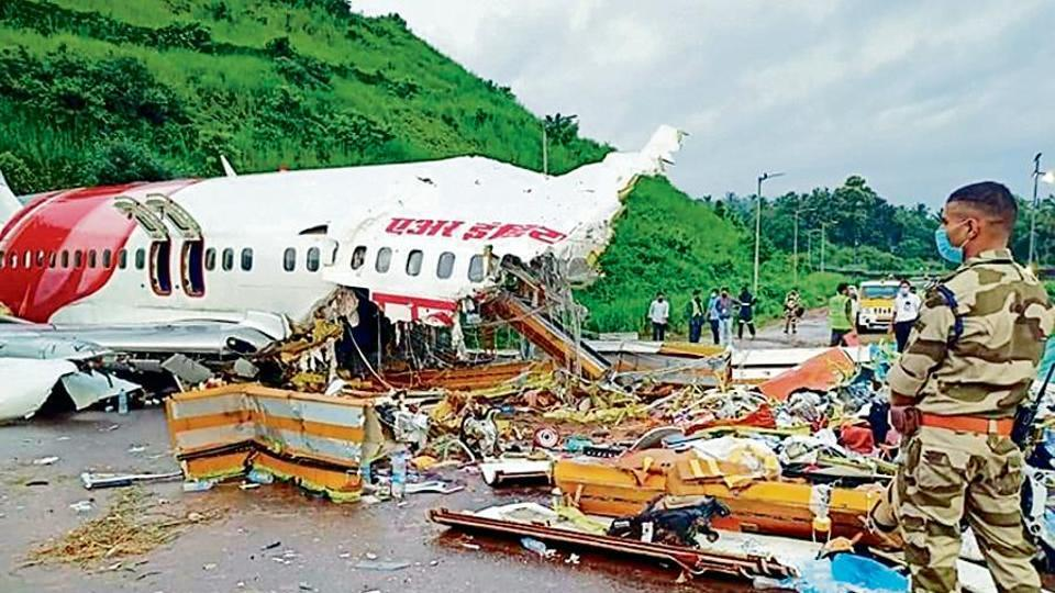 Officials inspect the wreckage of the Air India Express flight at the Kozhikode International Airport on August 8.
