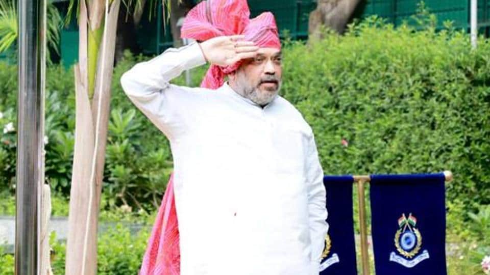 Home minister Amit Shah hoisted the national flag at his residence in New Delhi on the 74th Independence Day