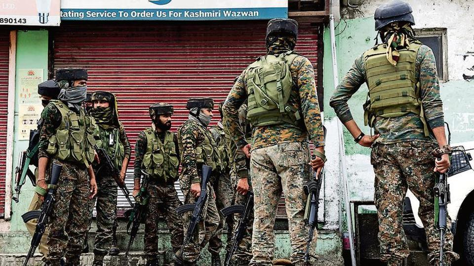 Security personnel inspect a spot after a terrorist attack in Nowgam on Friday.