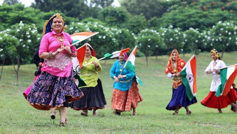 Women wearing traditional dresses celebrating the Independence Day by unfurling the national flag on the eve of Independence Day in Rohtak on Friday.  (Manoj Dhaka /HindustanTimes)