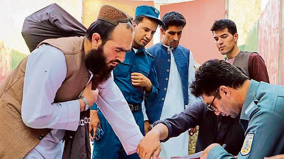 TIME TO GO: Policemen register Taliban prisoners as they are in the process of being released from the Pul-e-Charkhi prison on the outskirts of Kabul, Afghanistan.