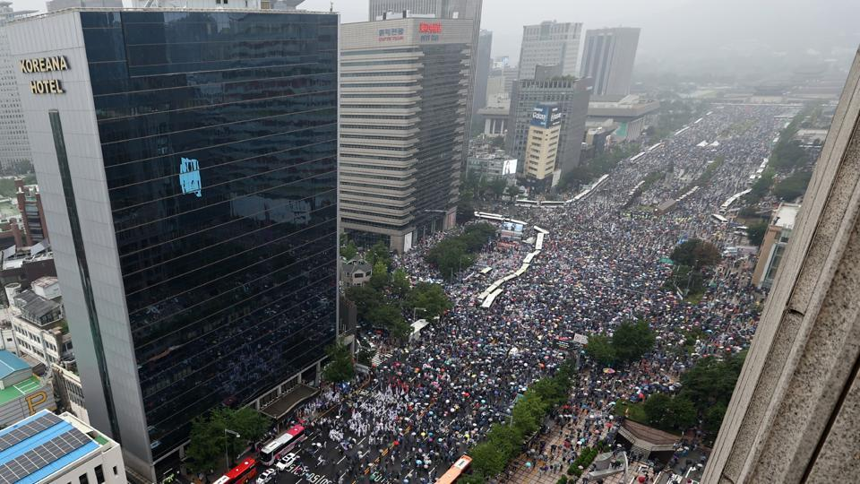 An aerial view of protesters marching during the anti-government protest in Seoul on August 15. Some marchers came from a church in northern Seoul that was shut down after it was linked to dozens of Covid-19 infections. (AP / PTI)