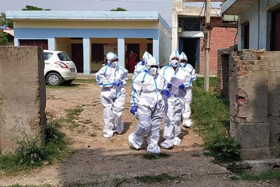 Health workers are seen in PPE suits in Panchkula, district of Haryana in this file photo. India has seen 830,204 Covid-19 cases since the beginning of this month and has been reporting over 60,000 cases every day since August 7.