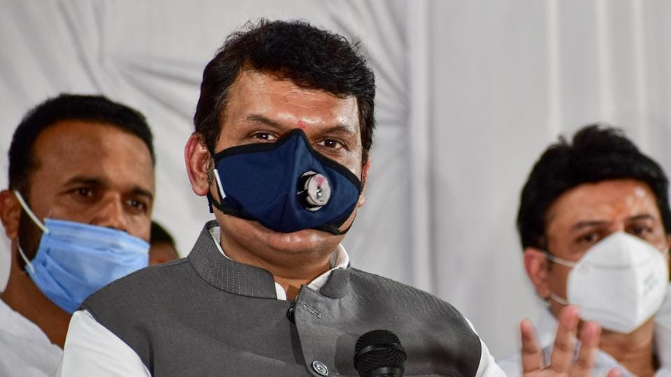 Former Maharashtra Chief Minister Devendra Fadnavis addresses a press conference after the Covid-19 review meeting, in Solapur.