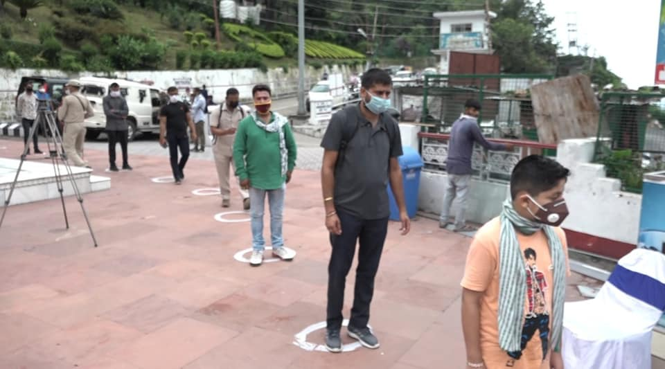 People on their way to the Vaishno Devi shrine in Jammu observe social distancing as the temple reopened on August 16, 2020.
