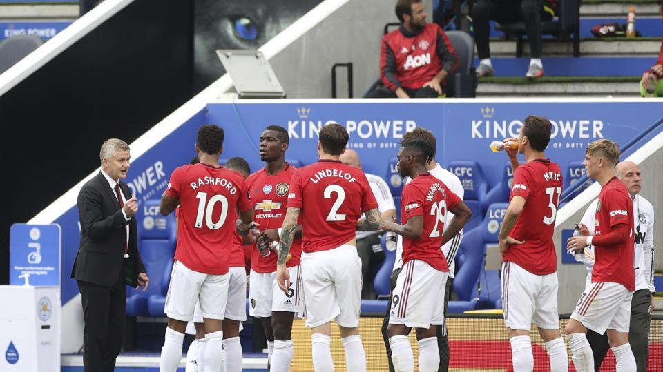 Manchester United's manager Ole Gunnar Solskjaer, left, gives instructions to his players during the English Premier League soccer match between Leicester City and Manchester United at the King Power Stadium, in Leicester, England, Sunday, July 26, 2020. (Carl Recine/Pool via AP)