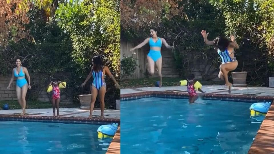 Sunny Leone swimming with daughter Nisha and a friend.