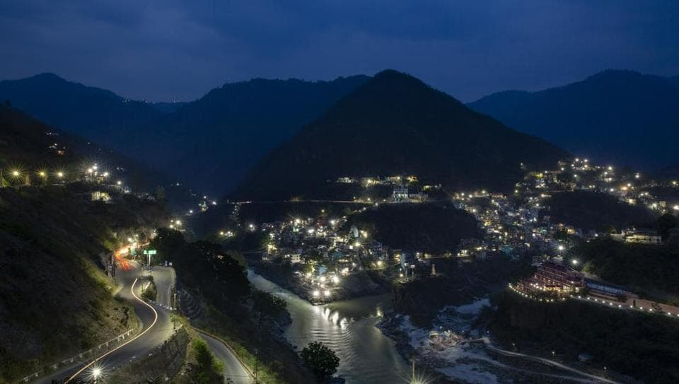 The confluence of Alaknanda and Bhagirathi rivers, which is officially accepted as the start of the River Ganges, is illuminated at twilight in the town of Devprayag, Uttarakhand.