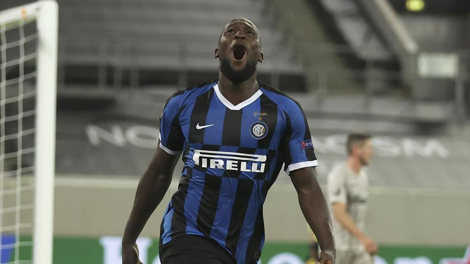 Inter Milan's Romelu Lukaku celebrates after scoring his side's fifth goal during the Europa League semifinal soccer match between Inter Milan and Shakhtar Donetsk at Dusseldorf Arena, in Duesseldorf, Germany, Monday, Aug. 17, 2020. (Lars Baron/Pool Photo via AP)