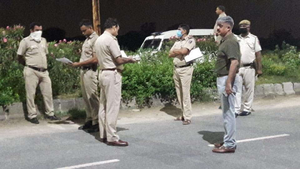 Delhi Police personnel at the spot where the shootout took place.