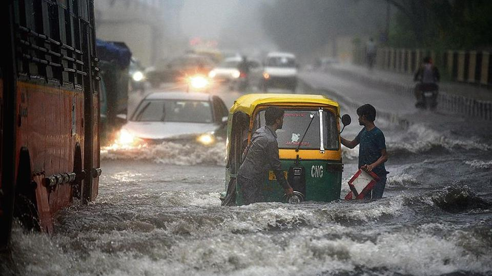 An auto breaks down on a waterlogged road in east Delhi on Monday