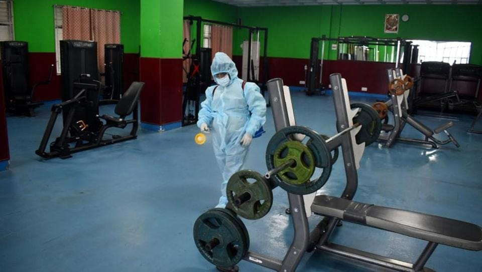 A worker sanitises the gym at Indira Gandhi Sports Complex in Shimla on Friday.