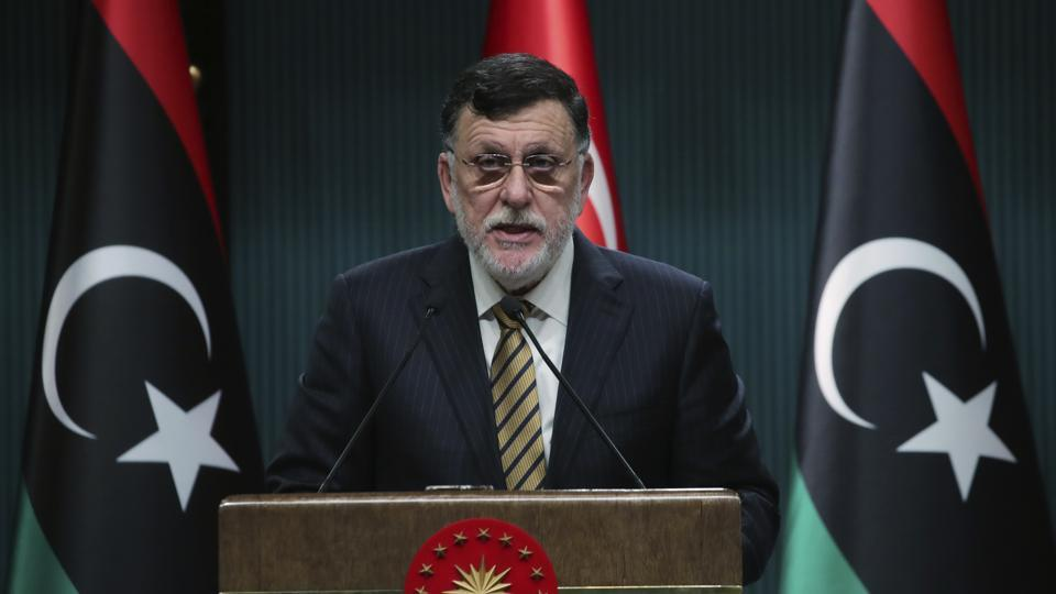 In this June 4, 2020 file photo, Fayez Sarraj, the head of Libya's internationally-recognized government, speaks at a joint news conference with Turkey's President Recep Tayyip Erdogan, in Ankara.