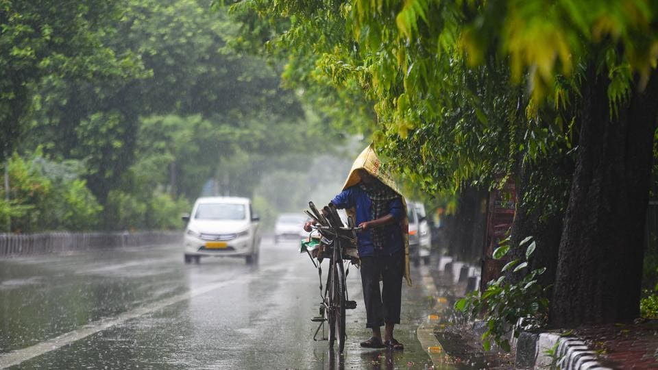 A commuter pushes his cycle under rain near Adchini in New Delhi on August 19. Delhi starts recording monsoon rain from June 1 and September 30 is considered the monsoon retreating date. The peak for rainfall activity is recorded between July 15 and the first week of  August . However, the monsoon officially arrived in Delhi this year only on July 24. (Amal KS / HT Photo )