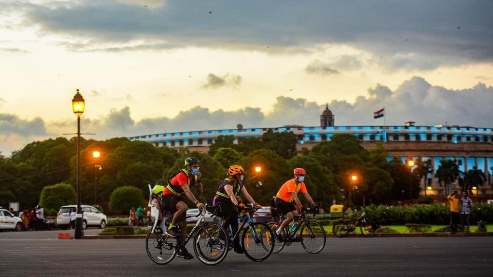 Cyclists ride past Parliament House on August 23. An AQI reading between 0 and 50 is considered 'good' with no health impact. A reading of '51-100' is considered 'satisfactory', which means it may have a minimal impact on the health of people with sensitivities such as chronic breathing difficulties. (Amal KS / HT Photo)