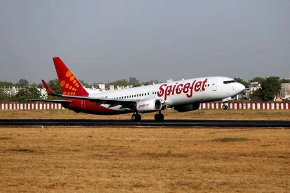 ASpiceJet passenger aircraft is seen at the Sardar Vallabhbhai Patel international airport in Ahmedabad in this file photo. SpiceJet on Tuesday reported a net loss of Rs 593 crore in the first quarter of FY21 against a profit of Rs 262 crore in the same quarter of previous year.