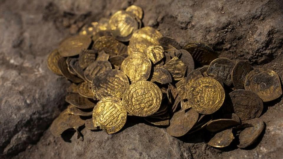 A hoard of gold coins discovered at an archaeological site in Central Israel .