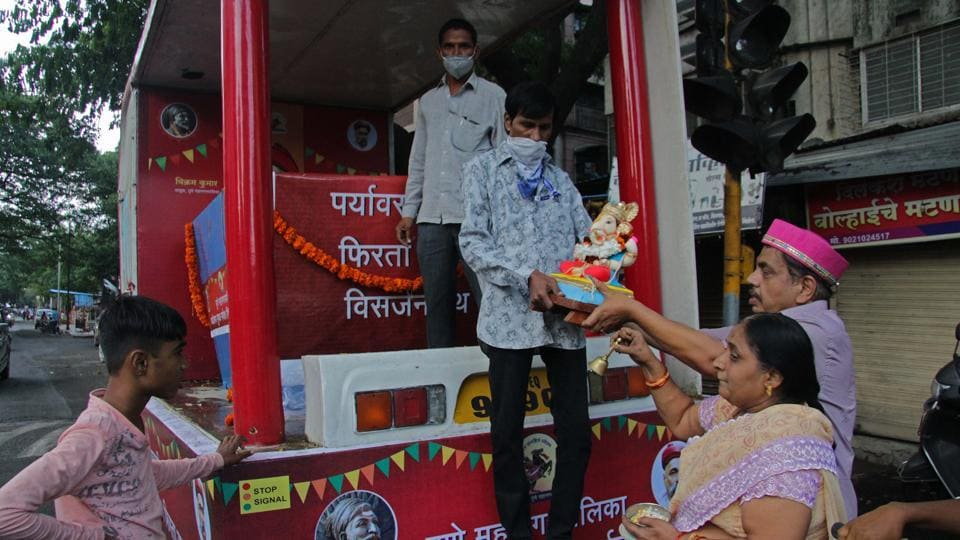 Citizen giving their Ganesha Idol for immersion to Pune Municipal Corporation's worker to immerse in mobile immersion tank at Taware colony, on Sunday.