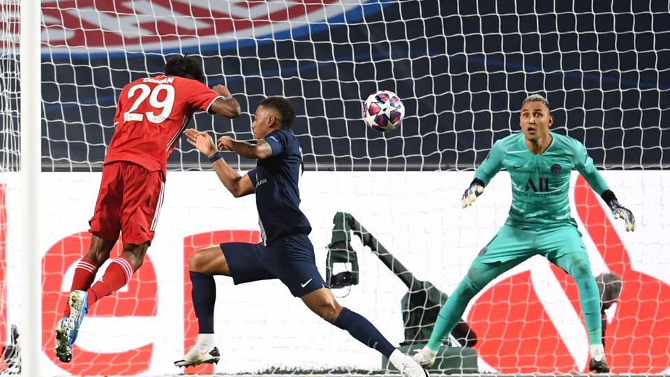 Bayern Munich's French forward Kingsley Coman (L) scores the winner against PSG in the final of the UEFA Champions League in Lisbon.