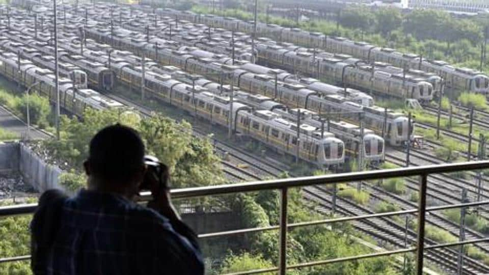 A man photographs Delhi Metro trains parked at Khyber Pass Metro Depot in New Delhi in this file photo. Metro services along with bars are likely to be allowed to resume from September 1.