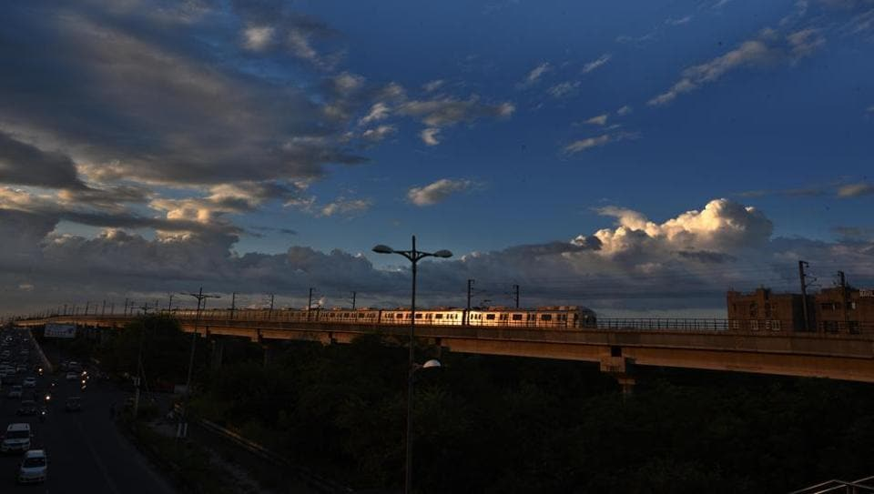 Clouds hover over a metro flyover during sunset in Mayur Vihar, New Delhi. (Photo by Ajay Aggarwal / Hindustan Times)