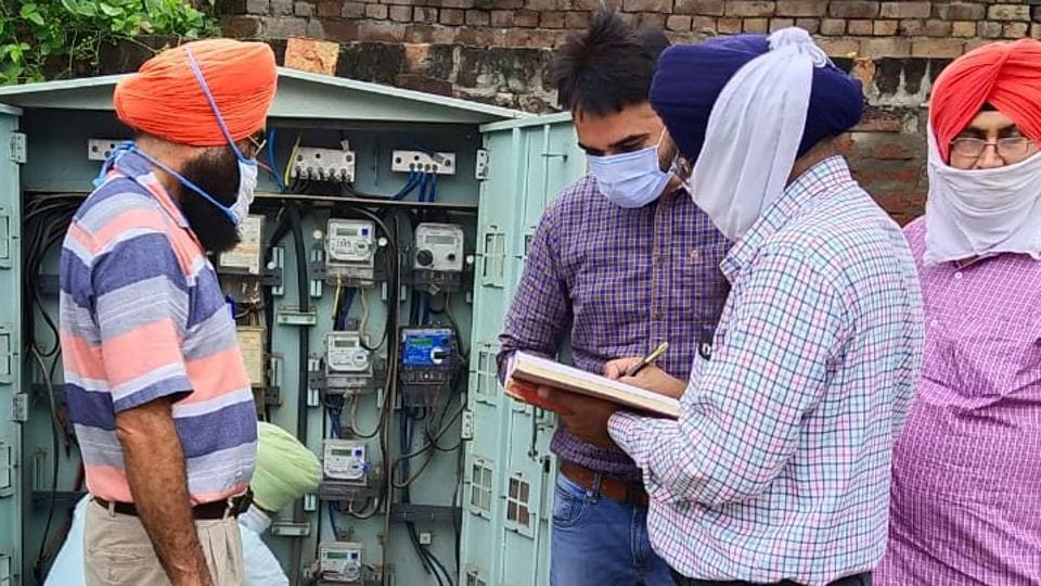 PSPCL officials checking electricity meters in Khanna on Thursday.