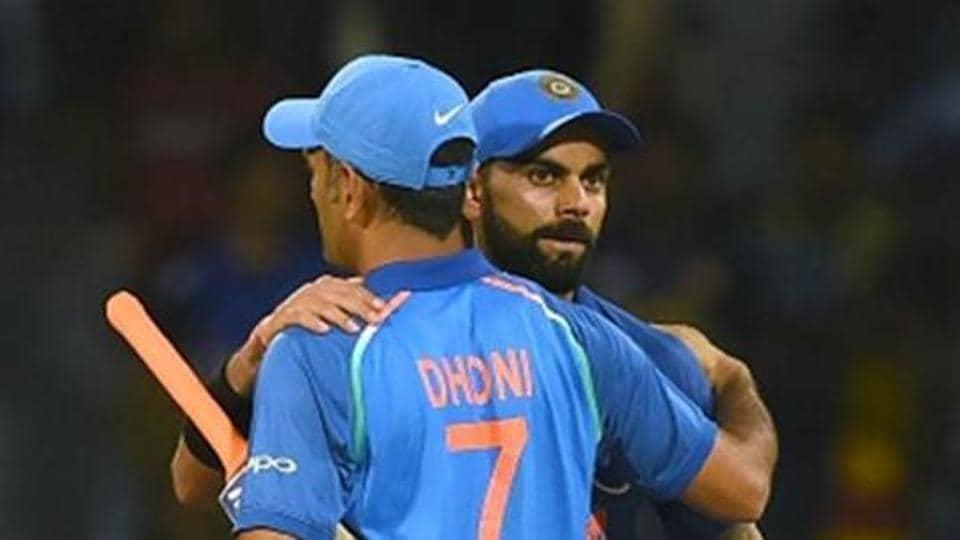 Indian cricket captain Virat Kohli (R) celebrates with teammate Mahendra Singh Dhoni (L)
