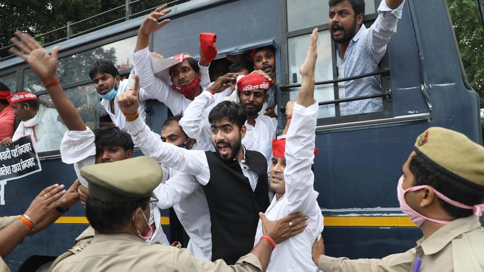 Police personnel detain Samajwadi party workers during a protest against the central government for conducting NEET and JEE exam amid the coronavirus pandemic near Raj Bhawan in Lucknow on Thursday.