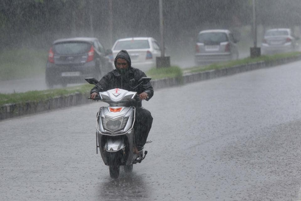 A commuter wading through the heavy rainfall inChandigarh on Friday.