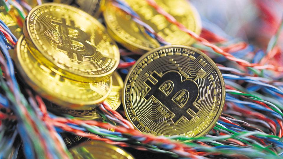 Bitcoins sit among twisted copper wiring inside a communications room at an office.