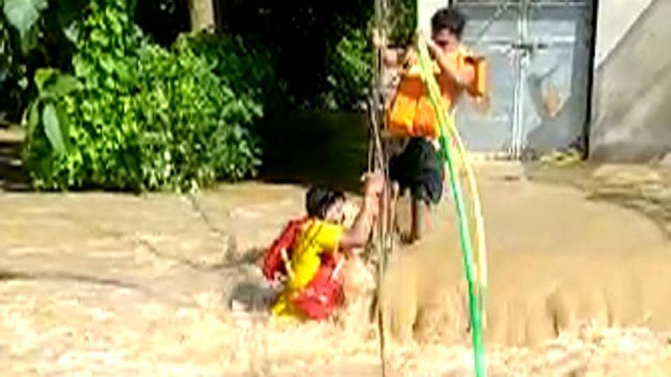 Fire services personnel of Bari Fire Station rescue 6 people, including a newborn baby, from a flooded village in Jajpur on Aug 28, 2020.