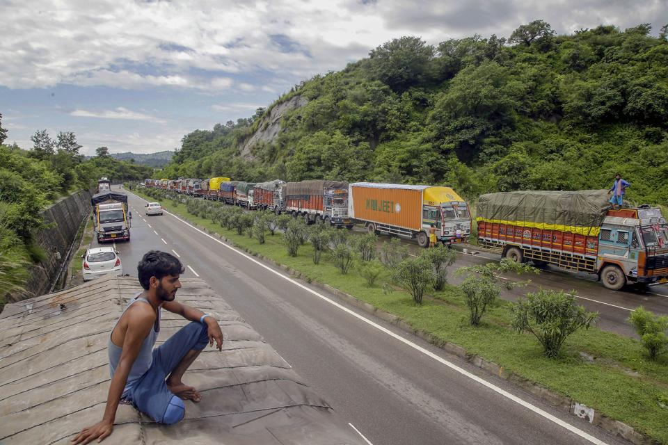 Stranded trucks wait for the opening of the Jammu-Srinagar national highway, on the outskirts of Jammu, on Friday.