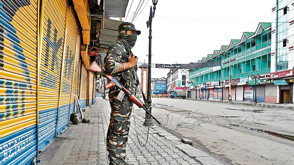 A security personnel stands guard in Srinagar.