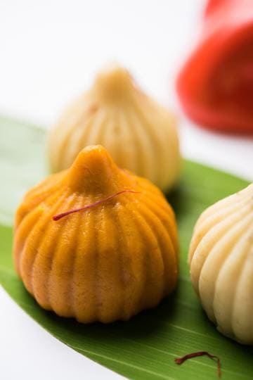In times of coronavirus, to partake of the neighbourhood pujas or sadhyas or not is the million-modak question.